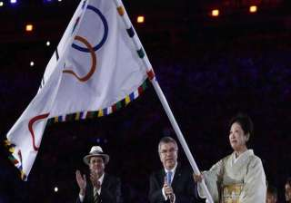 Governor of Tokyo Yuriko Koike accepts the Olympic flag on behalf of the city.