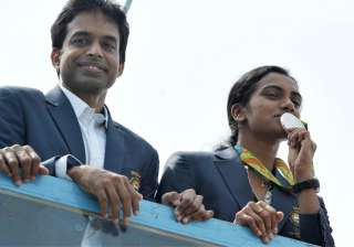 Amidst scenes of jubilation and a sense of pride, Olympics silver medallist P V Sindhu was on Monday accorded a rousing welcome on her arrival to home town and felicitated by Telangana government for her stupendous performance at Rio Games. The 21-year-old, who landed with her coach Pullela Gopichand, was received at Rajiv Gandhi International Airport by her parents P V Ramana and P Vijaya, some Telangana and Andhra Pradesh Ministers, amidst cheers from crowds.