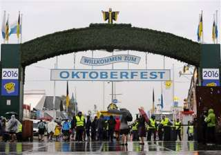 The world's largest and most famous beer festival, the Oktoberfest began on September 17 in the German city of Munich. It is a 17-day festival. In pic, visitors walk past security personnel through the main entrance of the Oktoberfest beer festival.