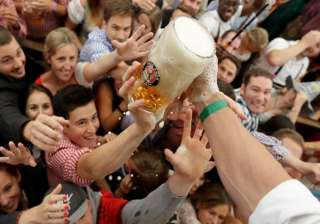 People struggle for free beer during the opening ceremony of the 183rd Oktoberfest beer festival
