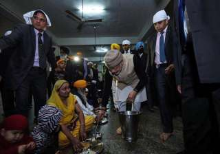 Prime Minister Narendra Modi today bowled us over with his down to earth attitude as he served langar at the Golden Temple in Amritsar. He along with Afghanistan President Ashraf Ghani arrived in the holy town to attend the Heart of Asia conference and had a visit to the Golden Temple. PM Modi also knelt and bowed five times before the Sikh Holy book and was honoured with a siropa. Catch his heart winning gesture in pictures: