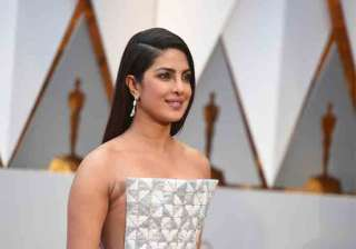 India Actress Priyanka Chopra stunned everyone with her glittering and glamourous look at the 89th Annual Academy Awards, which started at Dolby Theatre in Los Angeles. The Quantico star sported a Ralph and Russo column gown, which she paired with a dropping earring and matching chunky bracelet