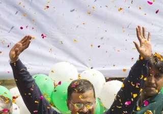 Leader of the Aam Aadmi Party, or Common Man's Party, Arvind Kejriwal waves to the crowd as his party looks set for a landslide party in New Delhi.