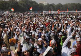 Supporters of Aam Aadmi Party cheer during the swearing in ceremony of party leader Arvind Kejriwal as chief minister of Delhi in New Delhi. The AAP, headed by the former tax official who had remade himself into a champion for clean government, won 67 of the 70 seats in recent elections.