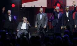 Former US presidents together at hurricane aid concert in