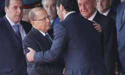 Lebanese President Michel Aoun is greeted by PM Saad Hariri