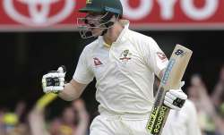 Steve Smith celebrates after he reached 100 runs during the