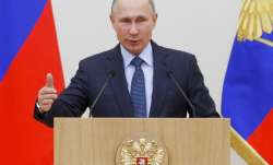 Vladimir Putin declares victory in Syria, announces partial