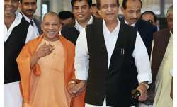 Yogi Adityanath, Azam Khan spotted walking hand-in-hand at
