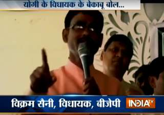 BJP MLA threatens to break limbs of those who...