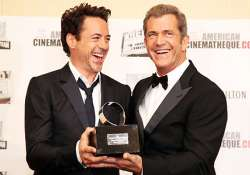 downey jr. asks hollywood to forgive mel gibson