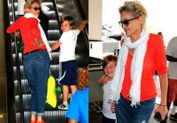 at 56 sharon stone goes brighter with colour orange