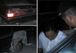 drunk driver in china sleeps inside car wheel number plate