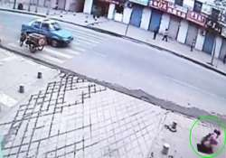 girl on phone accidentally falls through hole in pavement