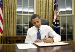 barack obama signs russia sanctions bill