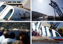 watch the half submerged costa concordia pics