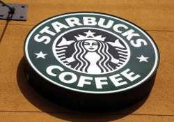 in symbolic move starbucks to open first shop in italy