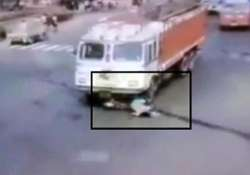 caught on camera woman escapes after speeding truck crushes