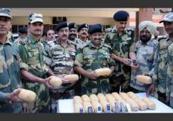 bsf recovers 18 kg heroin arms and ammunition from india