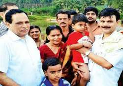 karnataka minister jumps into lake to save 6 people from