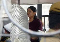 distressed kanimozhi takes to meditation in jail