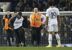 europa league game halted after 3 pitch invasions