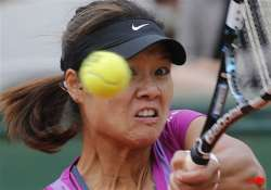 defending champion li knocked out of french open