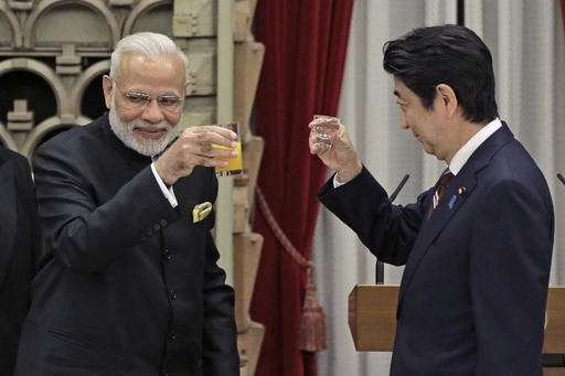 Prime Minister Narendra Modi and Shinzo Abe toast each other during a banquet hosted by Abe at his official residence in Tokyo, Japan on Friday.