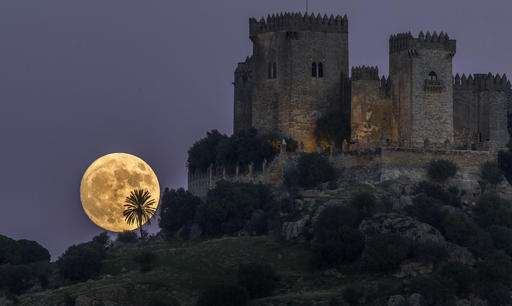 This picture from Southern Spain, of the moon rising behind the castle of Almodovar in Cordoba, is bound to take your breath away.