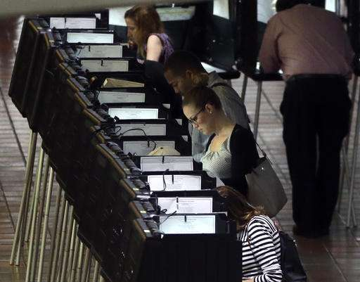In this photo from October 24, people vote at a polling station in Miami-Dade county for Miami.