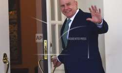National security adviser HR McMaster waves as he walks