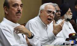 Congress leader Kapil Sibal addressing a press conference