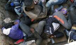 Migrants being expelled from Algeria lie in a truck headed