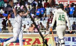 Indian bowler Umesh Yadav celebrates the dismissal of South