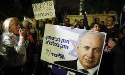 Supporters of Israeli Prime Minister Benjamin Netanyahu gather outside his residence in Jerusalem. I