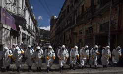 City workers fumigate a street to help contain the spread