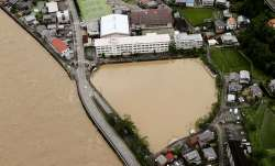 A schoolyard of a junior high school is seen flooded following heavy rains in Gero, Gifu prefecture,