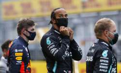 Mercedes driver Lewis Hamilton of Britain, center, stands
