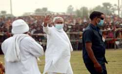 Bihar Chief Minister Nitish Kumar waves at the crowd during