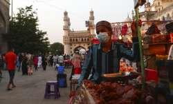 A vendor wearing a face mask as a precaution against