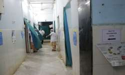 Health workers talk inside a vaccination centre.