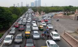 Vehicles on a busy Noida road.