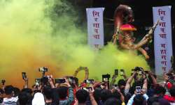 People raise their mobile to record the moments as devotees