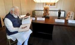 New York: Prime Minister Narendra Modi looks on at