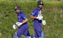 Rohit Sharma (left) and KL Rahul run between the wicket during the India vs Australia warm-up match