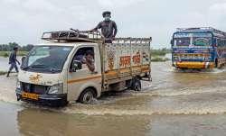 Birbhum: Vehicles wade through a flooded Suri-Katwa road at