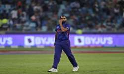 Indias Mohammed Shami reacts after he was hit by three