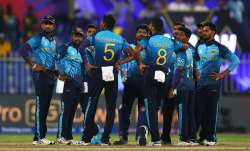 Sri Lankan players regroup after taking a wicket of the Netherlands in Sharjah on Friday.