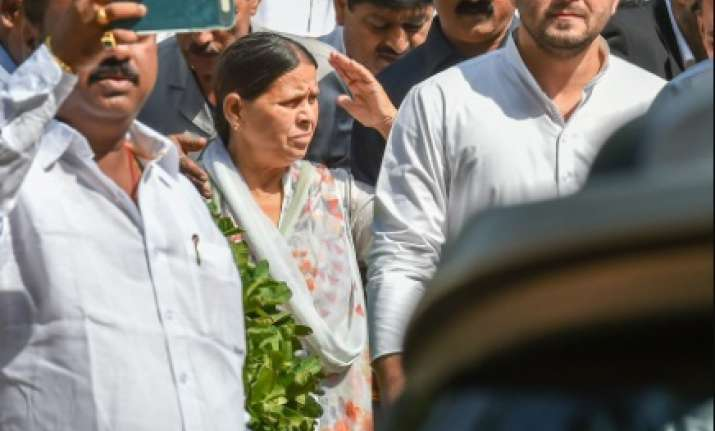 Former Bihar chief minister Rabri Devi with her son