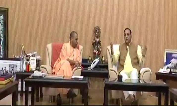 Gujarat Chief Minister Vijay Rupani with UP CM Yogi